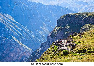 Colca canyon - Tourists at the Cruz Del Condor viewpoint,...