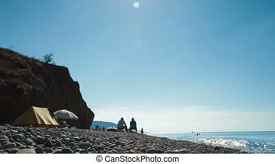 Tourists Camping by Sea