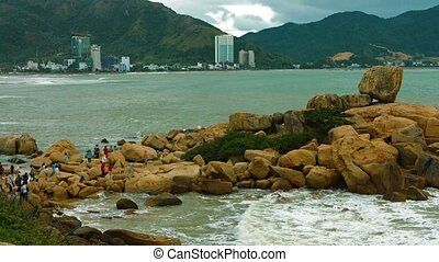 """""""Tourists explore and climb over the massive boulders of Hon Chong Rocks, a popular attraction in Nha Trang, Vietnam. Video Full HD"""""""