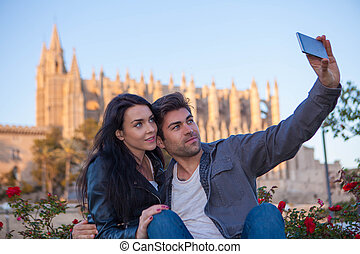 tourists couple at cathedral in Palma de Mallorca Spain