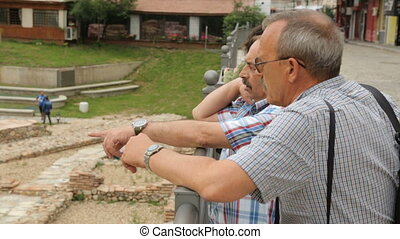 Tourists discussing ruins in Sofia