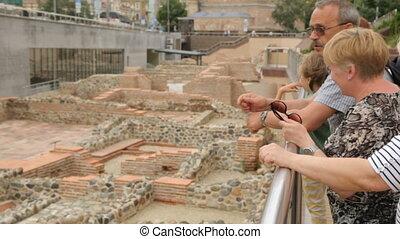 Tourists discussing ruins of Serdica in Sofia