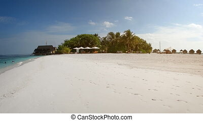 Tourists Enjoying a Beautiful Tropical Beach in the Maldives