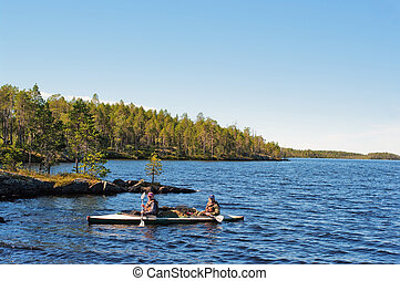 Tourists float in canoe