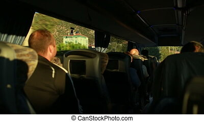 Tourists go by bus in a small town - tourists go by bus,...