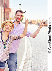 Tourists hailing a taxi