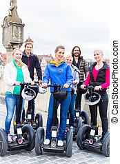 Tourists having Segway sightseeing - Tourist group having ...