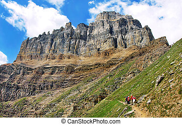 Tourists hiking in Rocky Mountains
