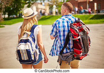 Tourists in foreign city - Young man and woman in casualwear...