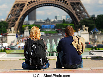 Tourists in France - Young tourist couple sitting in front...