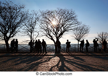 Tourists in Paris on observation platform looking at panorama of city