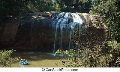 Tourists in Rafts Float beneath Waterfall in Dalat, Vietnam,...