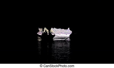 Tourists in traditional local boats being guided through the...