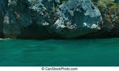 Tourists Kayaking under Towering Limestone Cliffs - FullHD...