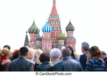 tourists look at st.Basil cathedral