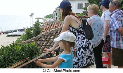 Tourists looking at sea near Balchik Palace