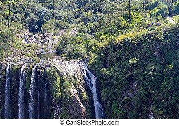 Tourists looking to Waterfall at Itaimbezinho Canyon