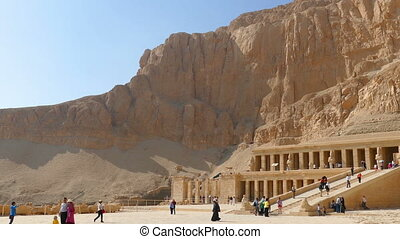 Tourists near ancient temple of Hatshepsut in Egypt - LUXOR,...