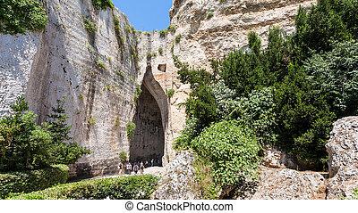 tourists near Orecchio di Dionisio in Syracuse - travel to...