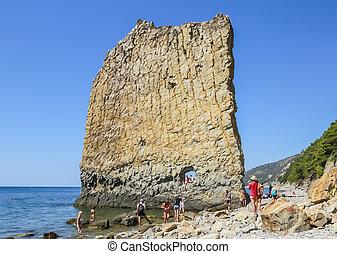 Tourists near Sail rock in Praskoveevka near Gelendzhik. Krasnodar Krai. Russia
