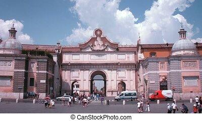 Tourists nearby Piazza del Popolo arch in Rome, Italy.