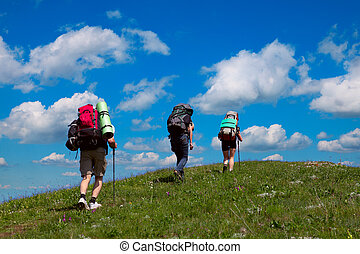 Tourists on a background of blue sky with clouds