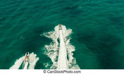 Tourists on a jet skis on a tropical resort. Boracay,...