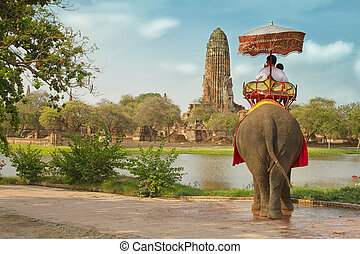 Tourists on an elephant ride tour of the ancient city...