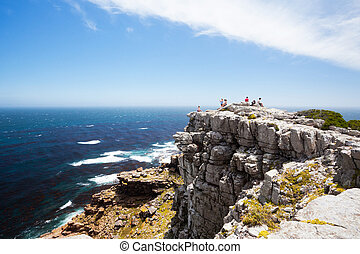 tourists on cape of good hope, south africa