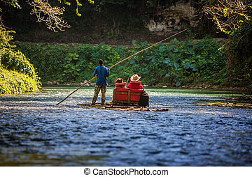 River Boat with tourists on Martha Brae River in Jamaica