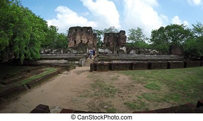 Tourists on the Steps of the Palace Ruin in Polonnaruwa, Sri...