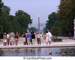 Tourists - Picture taking tourists in the Tuileries Gardens...