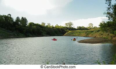 Tourists River Canoeing, Qld Island, Australia