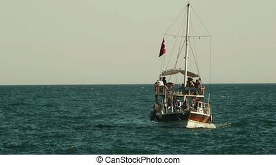 Tourists sailing on a motor boat in Mediterranean sea in Antalya, Turkey