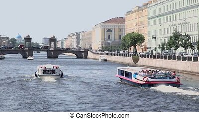 tourists ships float away by Fontanka river in Petersburg city