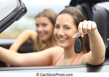 Tourists showing a rental car keys