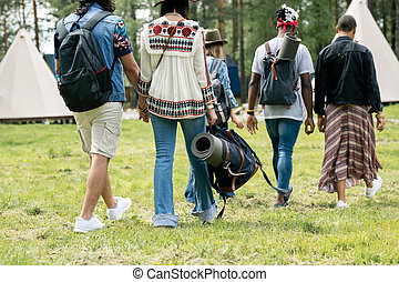 Tourists staying in camp - Rear view of multi-ethnic ...