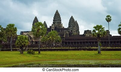 Surreal, abstract shot of visitors strolling in front of the ancient, Angkor Wat temple complex near Siem Reap, Cambodia, in timelapse. Video UltraHD