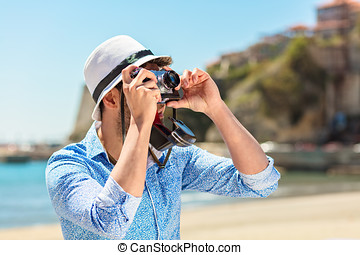 Tourists taking photo in the city at vacation
