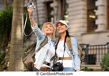 tourists taking self portrait - happy tourists taking self...