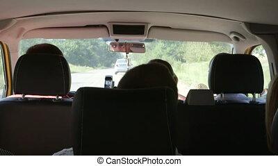 tourists traveling in minivan