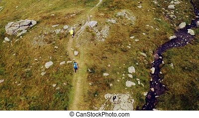 Tourists trekking majestic Alps - Aerial view of tourists ...