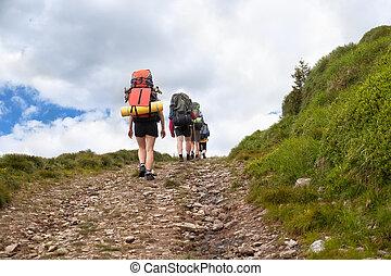 tourists trekking on dirt road