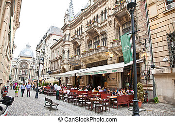 Tourists visit Old Town in Bucharest, Romania. - BUCHAREST-...