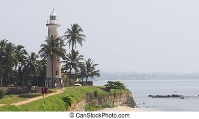 Tourists Visiting Lighthouse of Galle Fort in Sri Lanka - ...