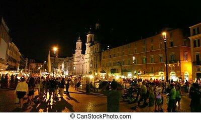 Tourists walk on Piazza Navona - ROME - JULY 2: Tourists...