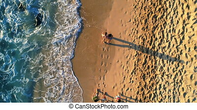 Tourists walking at beach 4k - Aerial view of tourists...