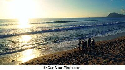 Tourists walking at beach 4k - Tourists walking at beach at...