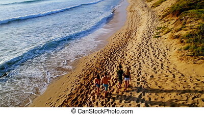 Tourists walking at beach 4k - Tourists walking at beach on...