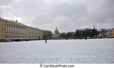Tourists walking on Dvortsovaya square, St. Petersburg, Russia